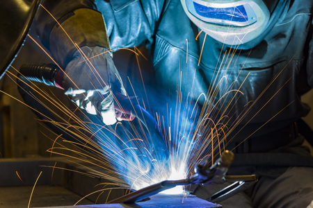 welder, craftsman, erecting technical steel Industrial steel welder in factory