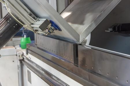 operator bending metal sheet by sheet bending machine sheet bending machines Stock Photo