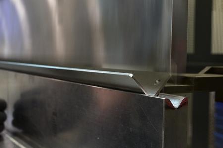 operator bending metal sheet by sheet bending machine bending of metal