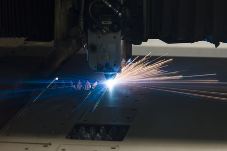 Industrial Laser cutting processing manufacture technology of flat sheet metal steel material with sparks laser cut metal splashes Banco de Imagens