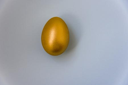 gold egg on white background