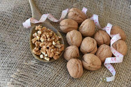 On burlap, peeled walnuts peeled on a wooden