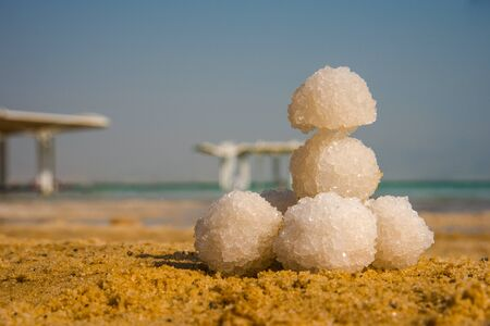 Relax balls of salt on the sand. Sky horizon. Sea. Sand. Dead Sea.