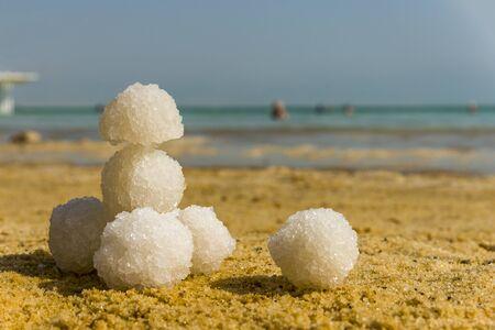 Relax balls of salt on the sand. Sky horizon. Sea. Sand. Dead Sea.