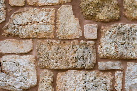 Texture of wall made of unevenly cut Jerusalem stones. jerusalem stone wall