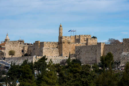Tower of David or Jerusalem Citadel at golden sunset. Jerusalem Israel . View of the Tower of David in the sunset light, near the Jaffa Gate