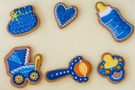 greeting card with newborn baked cookies on colored paper For baby birthday day Banco de Imagens