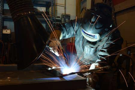 The welder is welding metal, erecting technical steel Industrial steel welder in factory technical, Banque d'images