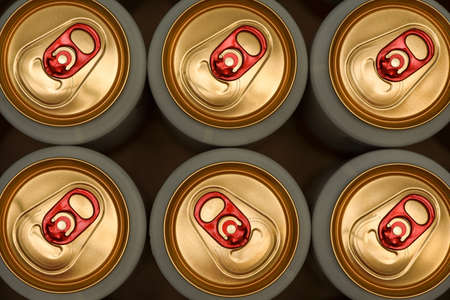 aluminum cans with carbonated water, energy drinks or beer. the view from the top. Top view tin beer cans background.