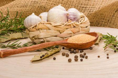 garlic bulbs with garlic cloves, Fresh garlic and dry garlic in a wooden spoon.