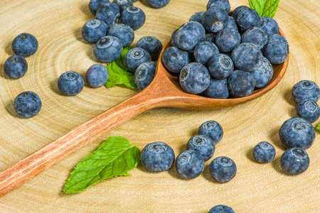 Blueberries in a wooden spoon.