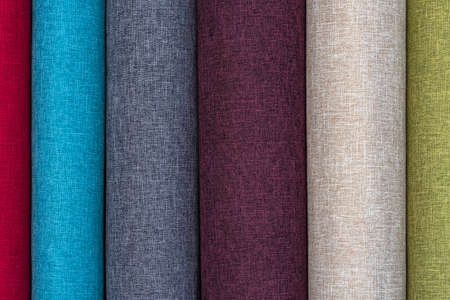 Closeup detail of multi color fabric texture samples. Material color fabric I am in spools of different colors.