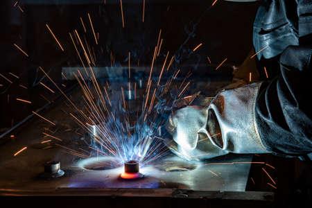 welder, craftsman, erecting technical steel Industrial steel welder in factory technical, Welding spatter metal. Banque d'images