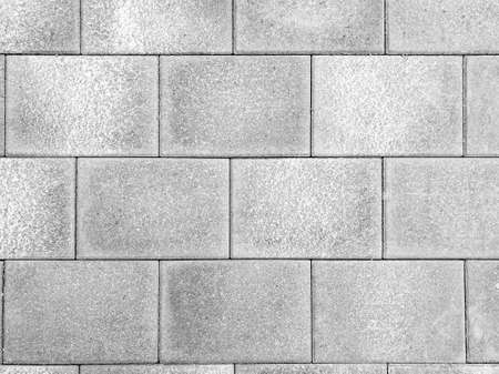 Gray brick wall texture background. Tiled. Gray wall from bricks background.