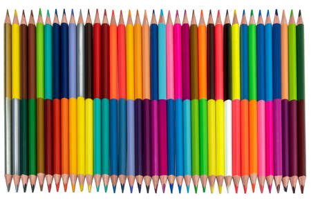 double-sided colored pencils on one side are laid out in order on the other in a scatter