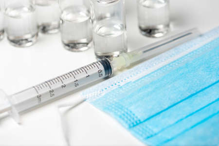 vaccine vial a illustrative picture, doctor in the laboratory with a biological tube for analysis and sampling of virus