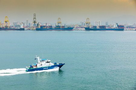 polis: Port Cargo ship and Crane lifting for cruising or product , Police boat
