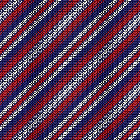 Knitted stripes pattern. Seamless diagonal lines knit texture in red, dark blue, and white for modern Christmas and New Year jumper, socks, wrapping paper, or other winter textile design.