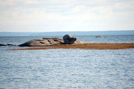 sandbar: Rocks out on water