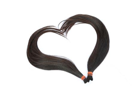 forme: Donate cheveux patient cancéreux isolé sur fond blanc, en forme de c?ur délié