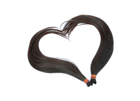Donate hair to cancer patient isolated on white background, hairline heart shape