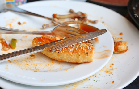 food waste: Food waste, piece of pizza remains on plate