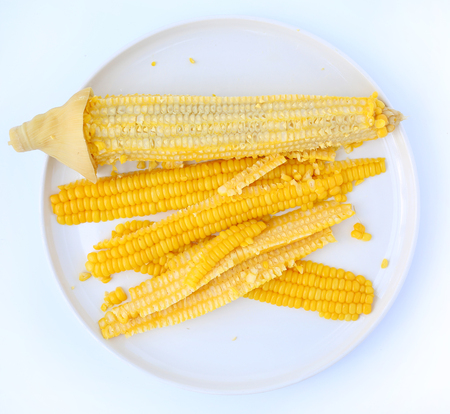 Sliced Boiled sweet corn in white circle plate ready for eat