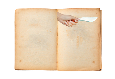 talisman: Open old book with image of Hand holding thai traditional knife with talisman symbol on it isolated on white background Stock Photo