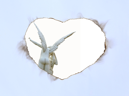 Paper art sheet Burning in shape of heart with image of angel statue on white background