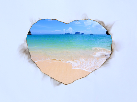 Paper art sheet Burning in shape of heart with image of Sea