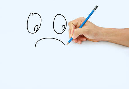 Hand holding a pencil on a white paper background, Drawing with pencil for image of Sad Stock Photo