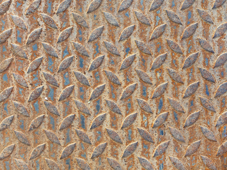 Rusty diamond steel plate texture background Stock Photo
