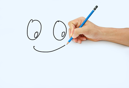 Hand holding a pencil on a white paper background, Drawing with pencil for image of Smile Stock Photo