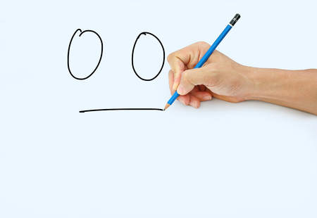 Hand holding a pencil on a white paper background, Drawing with pencil for image of Inaction