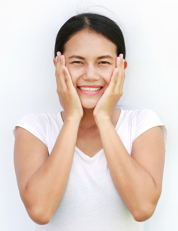 respectful: Close up asian woman touching her cheek with smile on white background