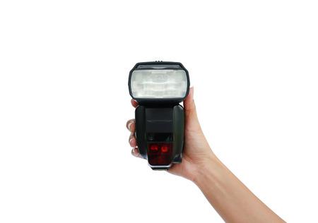 Mano che regge una luce flash isolata su sfondo bianco Archivio Fotografico - 90937939