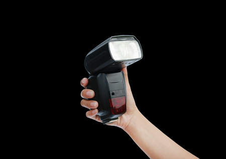 hand holding a flash light isolated on black background