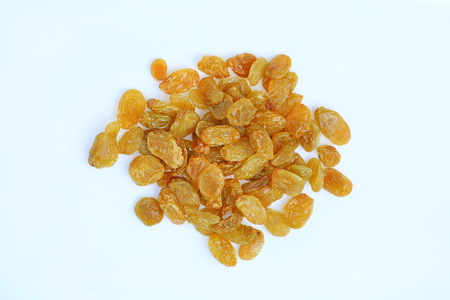Yellow raisins on white background. Top view. Standard-Bild