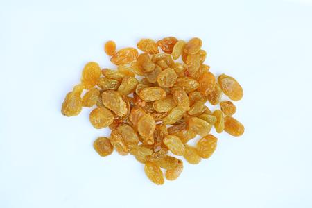 Yellow raisins on white background. Top view. Stockfoto