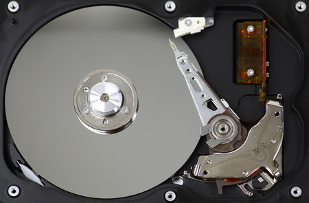 Harddisk drive (HDD) with top cover open on white background