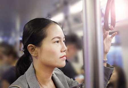 Young Asian woman inside a public transportation in Bangkok, Thailand. Stock Photo