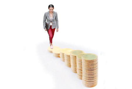 Business woman walking up on growing of gold coins stack to goal isolated on white background, Business Finance and Money concept.