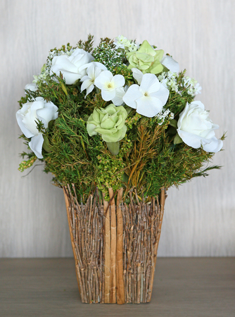 Bouquet Of Artificial White Roses In Recycle Vase Stock Photo