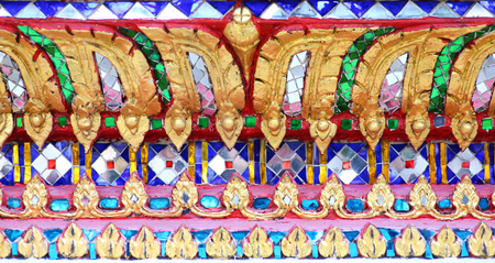 Close up of wall is decorated with stained glass small plate Traditional Thai mosaic art of temple. Stock Photo