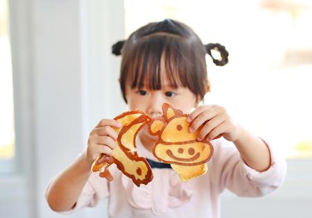Little girl showing Homemade pancake