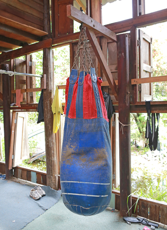 Boxing sand bags hanging at a sports gym