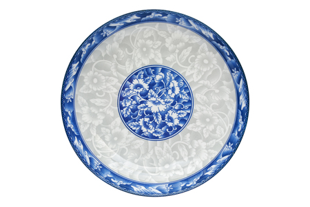 Blue and white porcelain of the flower pattern on dish isolated on white background. Above view