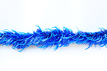 Blue colors bunch fur or Christmas tree tinsel garland on white background. Christmas and New year celebration. 스톡 콘텐츠