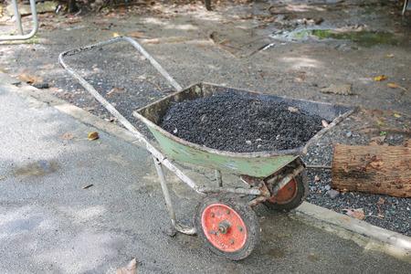 Fresh asphalt in metal cart ready to use.