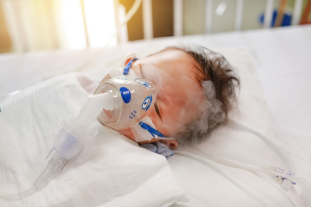 Inhalation baby boy age about 1 years old on patient bed. Respiratory Syncytial Virus (RSV). Intensive care on bed at hospital.